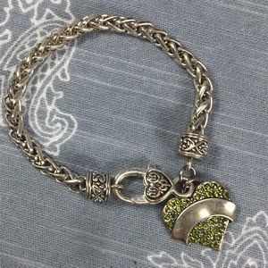 Jewelry - Silver tone bracelet with green heart